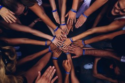 community hands in circle